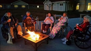 Residents enjoy time around the campfire